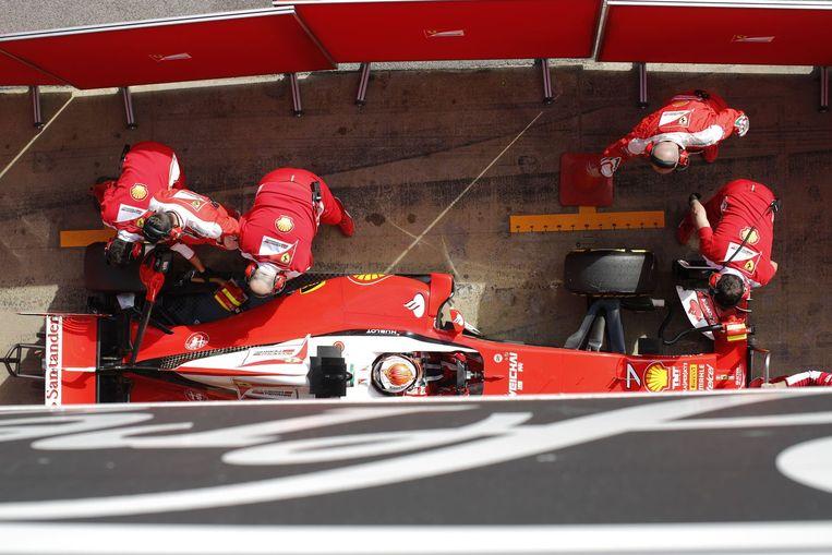 Kimi Räikönnen in zijn Ferrari. Beeld photo_news