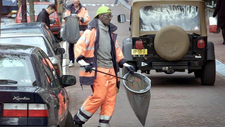 Medewerkers van een reinigingsdienst. © ANP Beeld
