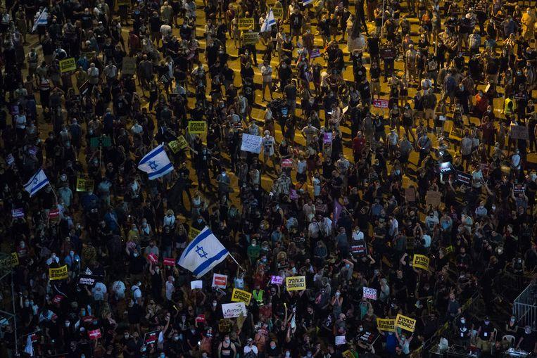 Het protest zaterdagavond op het Rabinplein in Tel Aviv. Beeld Getty Images
