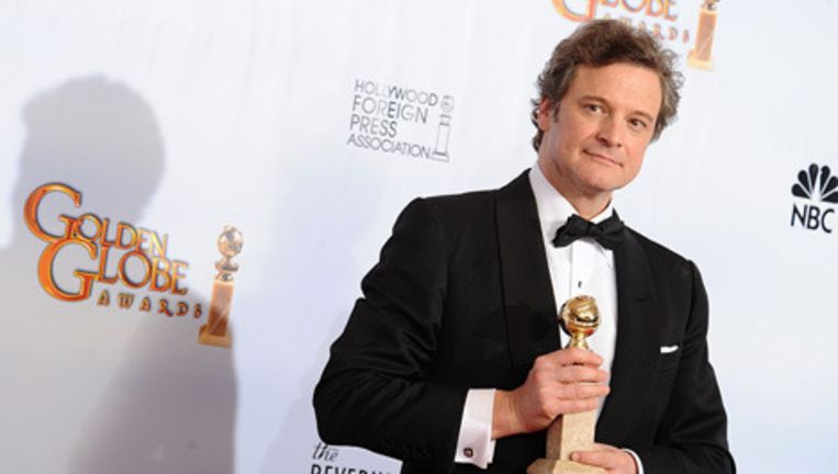 Colin Firth met zijn Golden Globe. Foto Bruno Press Beeld