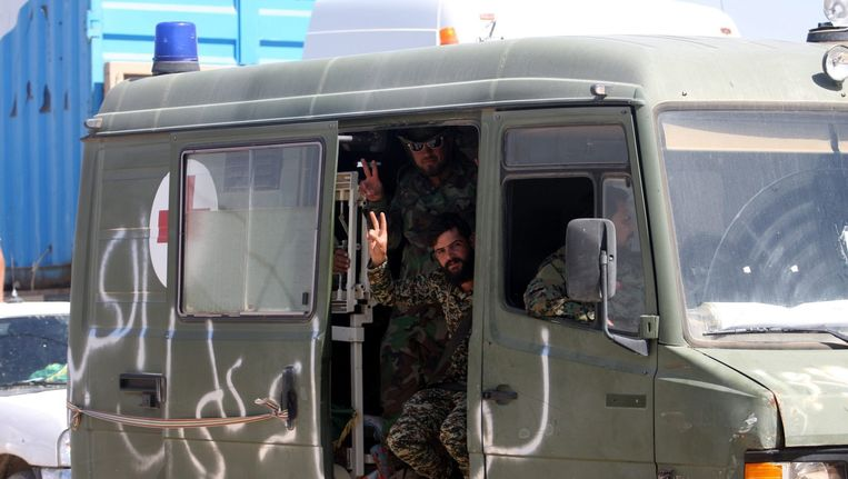 Iraakse strijders in de stad Karbala na een overwinning op IS. Beeld anp