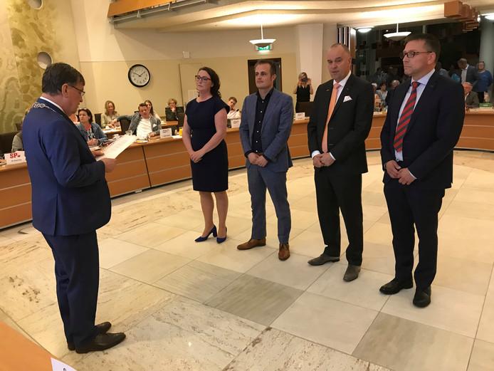 De vier nieuwe Udense wethouders , vl nr Ingrid Verkuijlen, Gijs van Heeswijk,  Maarten Prinssen en Franko van Lankvelt