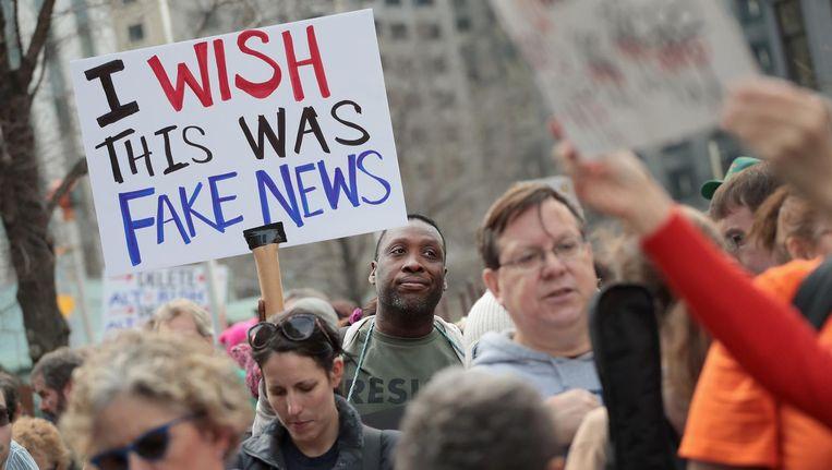Een Amerikaan tijdens een protest in de buurt van Trump Tower, 2017. Beeld AFP