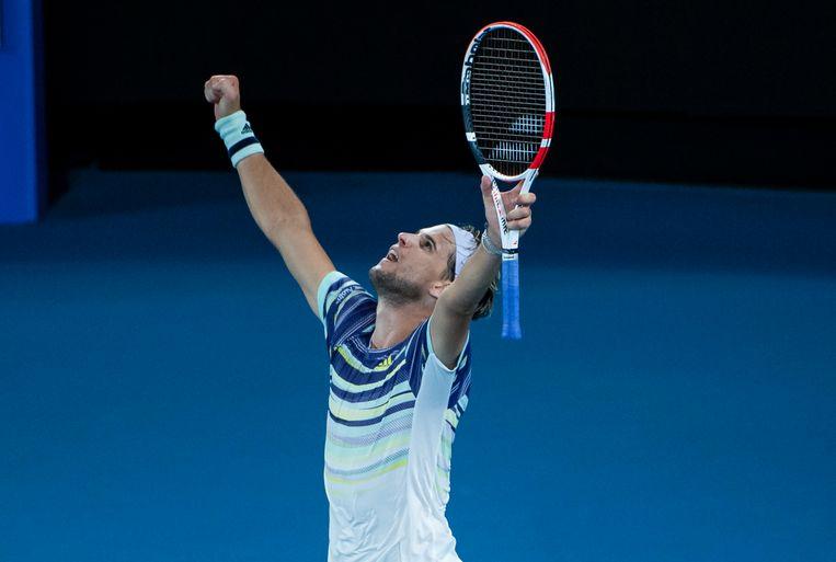 Dominic Thiem viert de overwinning.  Beeld Getty Images