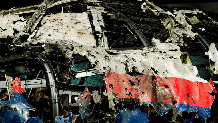 Schade aan de reconstructie van het vliegtuig vliegtuig tijdens de presentatie van het rapport van de Onderzoeksraad voor Veiligheid (OVV) met de resultaten van het onderzoek naar de oorzaak van de ramp met vlucht MH17. Beeld anp