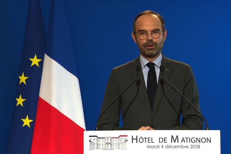 De Franse premier Edouard Philippe kondigt dinsdag op tv concessies aan na de protesten van de 'gele hesjes'.  Beeld AFP