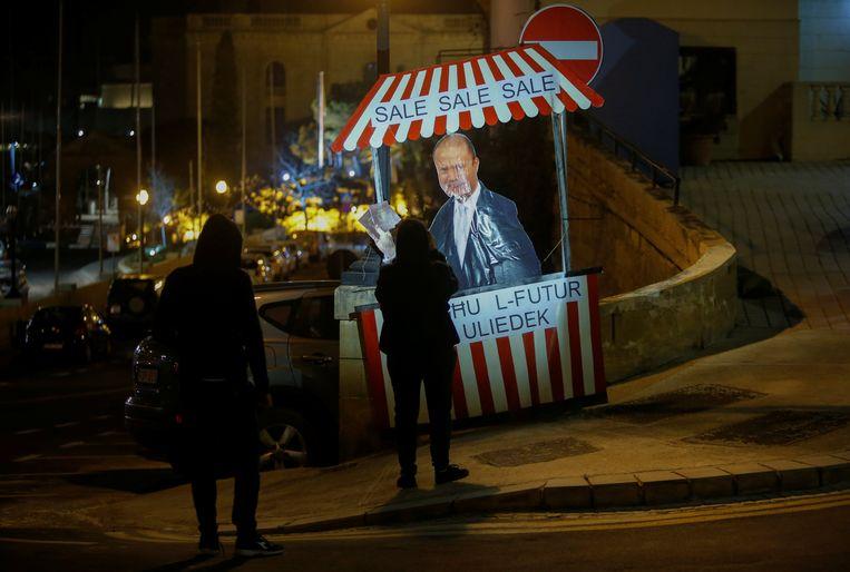 Protestactie tegen de Maltese premier Joseph Muscat: de uitverkoop van de toekomst van onze kinderen. Beeld Reuters