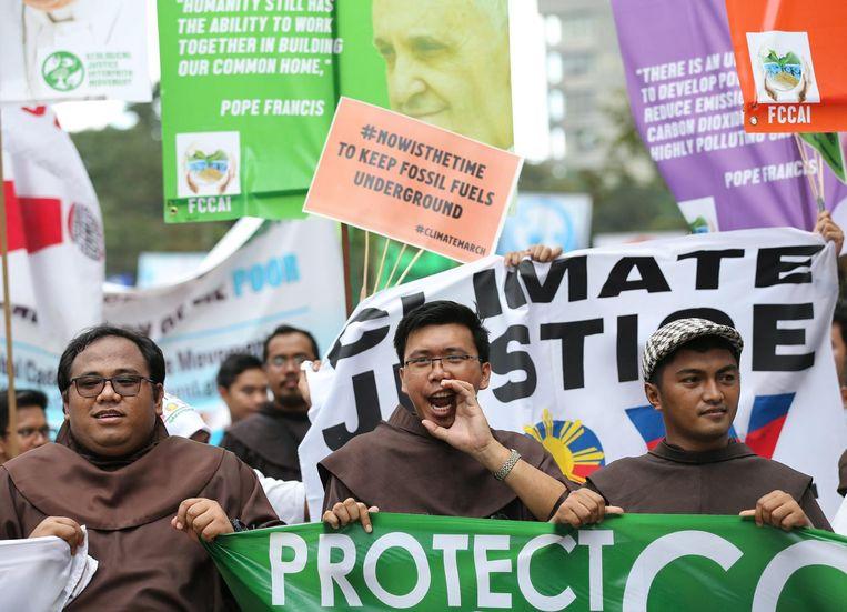Een klimaatmars in de Filipijnen in 2015. Beeld epa