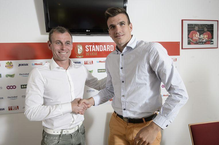 Ivan Santini schudt sportief raadgever Axel Lawarée de hand.