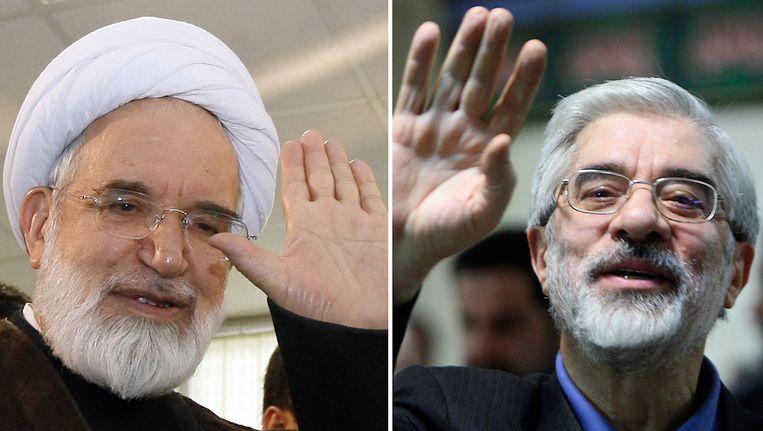 Oud-parlementsvoorzitter en oppositieleider Mehdi Karrubi en voormalig premier Mousavi (rechts). Beeld AFP