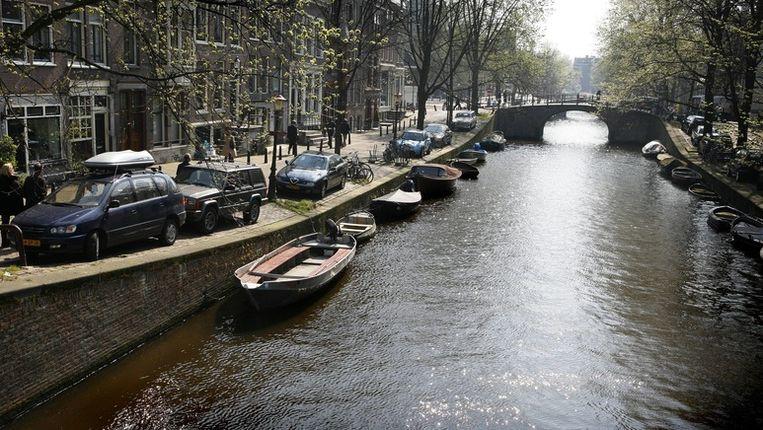 Het water van de Reguliersgracht was ijskoud Beeld Floris Lok