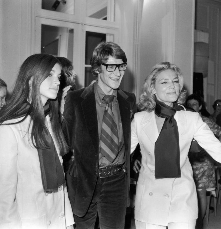 1968, in Parijs met dochter Leslie en Franse modeontwerper Yves Saint-Laurent. Beeld getty
