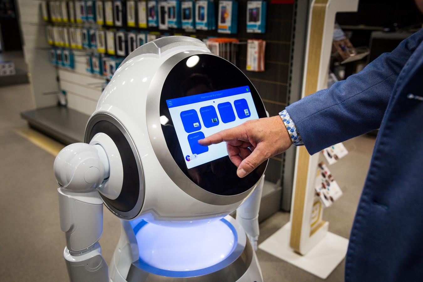 Even aanraken en de robot verwelkomt de klanten