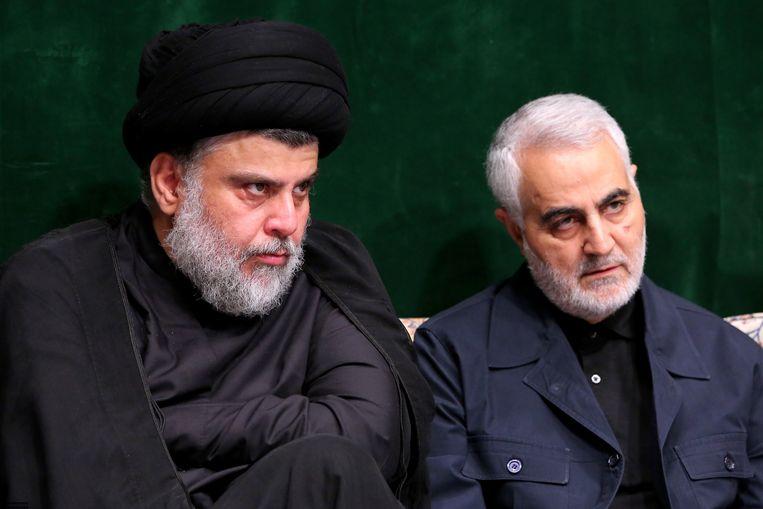 Archiefbeeld. De Iraakse sjiitische leider Muqtada al-Sadr naast de Iraanse generaal Qassem Soleimani die overleed bij een Amerikaanse luchtaanval.