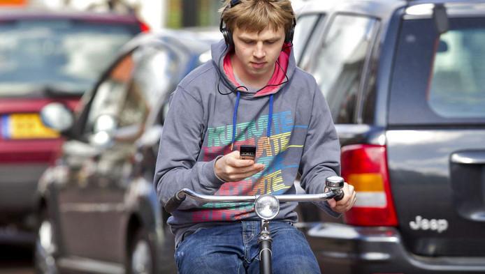 appen op de fiets wordt verboden nieuws adnl
