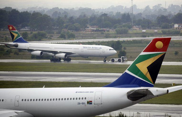 Vliegtuigen van South African Airways (SAA) op het internationale vliegveld van Johannesburg, Zuid-Afrika. Beeld REUTERS