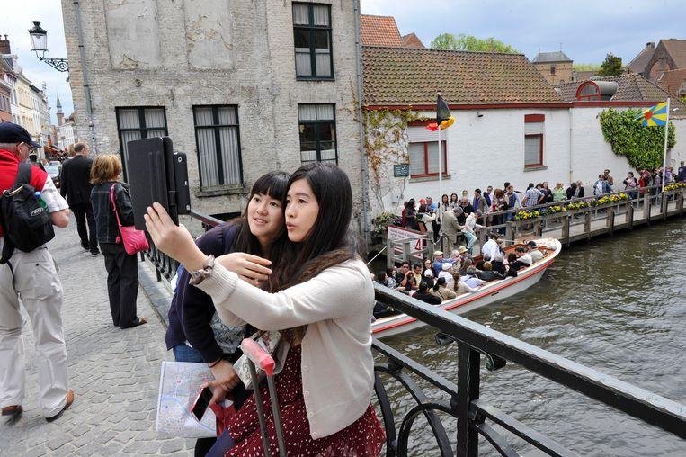 Chinese toeristen in de Brugse binnenstad.