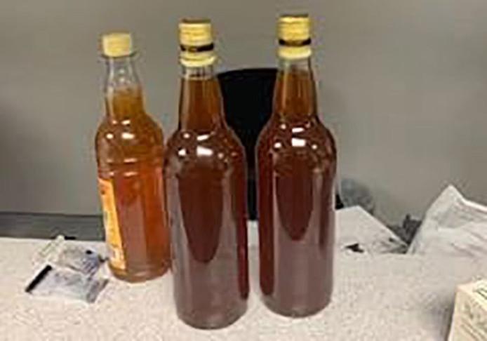 De drie flesjes honing