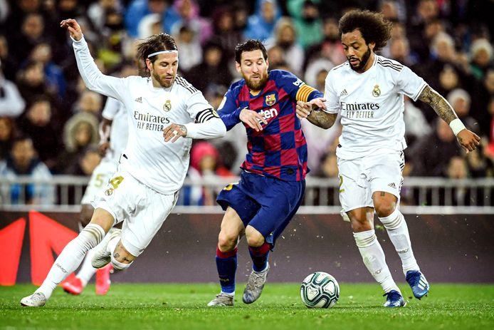 Lionel Messi in duel met Sergio Ramos en Marcelo.