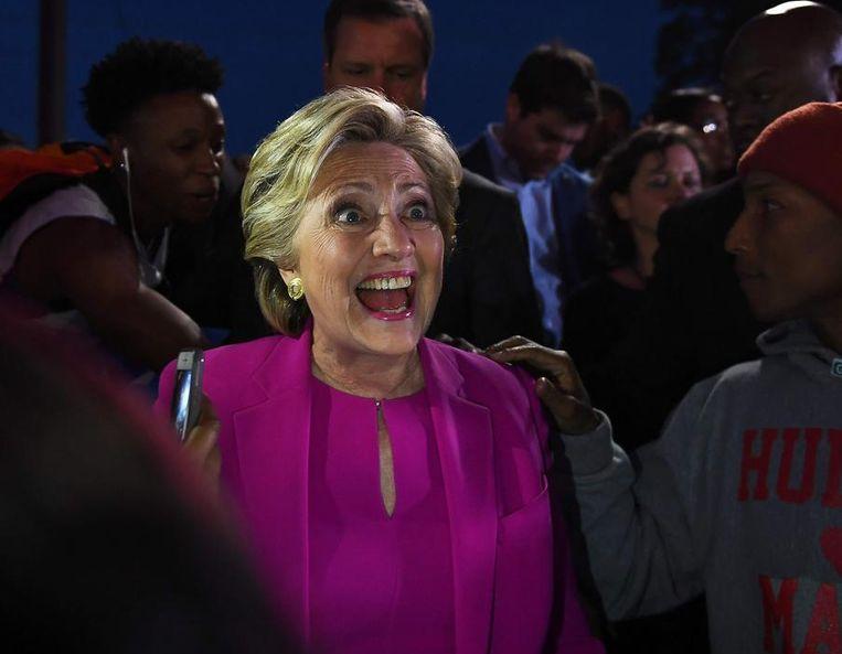 Hillary Clinton met zanger Pharrel Williams. Beeld afp