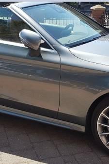 Dure auto's, vuurwapen, tienduizenden euro's cash en drugs aangetroffen in Helmond: drietal aangehouden