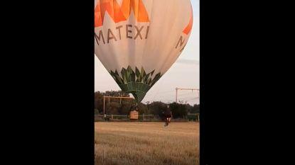 Straffe beelden: luchtballon komt in problemen in Lede en ontsnapt net aan aanstormende trein