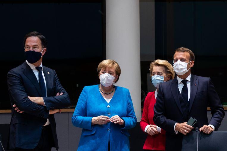 Nederlands-Duits-EU-Frans-onderonsje: Mark Rutte, Angela Merkel, Ursula von der Leyen en Emmanuel Macron. Beeld Hollandse Hoogte / EPA