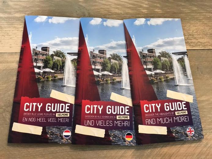Drie city guides, die door Helmond Marketing werden uitgegeven in het Nederlands, Duits en Engels