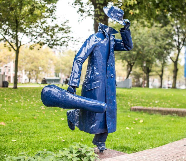 De man met vioolkist bij de Marnixstraat Beeld Eva Plevier