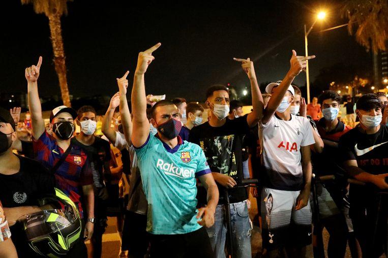 Supporters van de Spaanse voetbalclub zijn niet blij met het besluit van clubicoon Lionel Messi.   Beeld Reuters