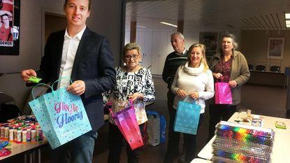 Sp.a en Curieus geven keileuke kerstcadeaus aan kansarme kinderen