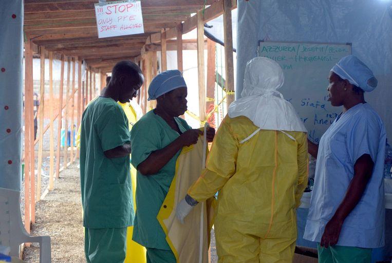 Hulpverleners in Liberia. Beeld ANP