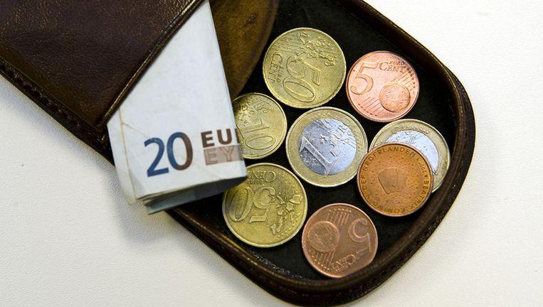 Nog geen zes maanden geleden was de Europese munt nog meer dan 1,51 dollar waard. Zaterdag zakte de euro voor het eerst in meer dan acht jaar onder de 1,20 dollar. Foto ANP Beeld
