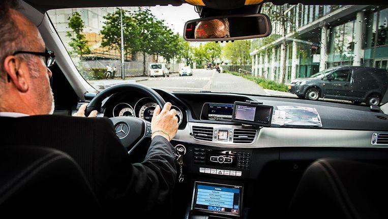 Het werk van de Amsterdamse taxichauffeur wordt er niet makkelijker op Beeld ANP
