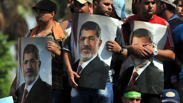 Morsi-aanhangers in Caïro. Beeld ANP