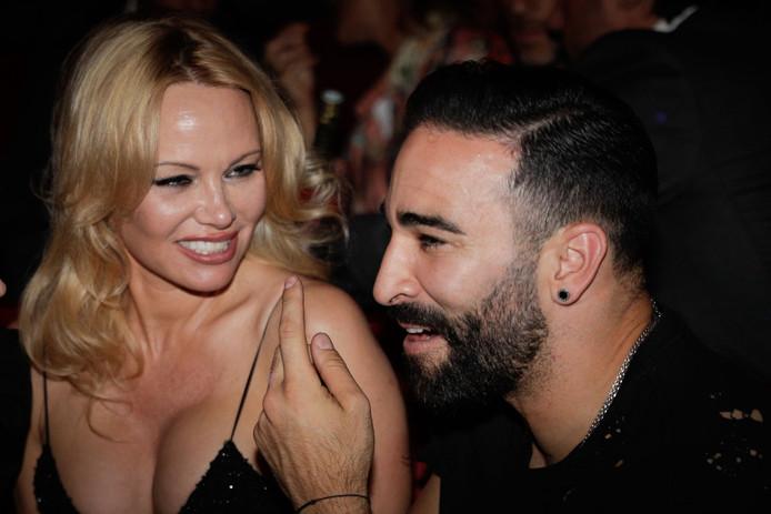 """Pamela Anderson et Adil Rami, à la première du spectacle """"Bionic ShowGirl"""", au Crazy Horse, le 3 juin 2019."""
