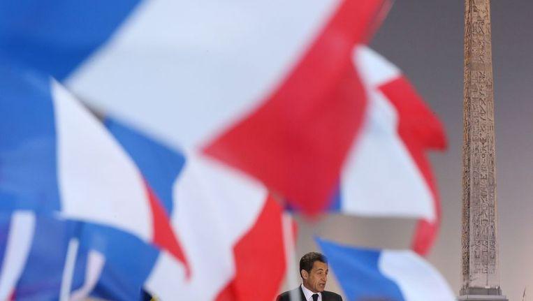 President Sarkozy houdt een speech in Parijs. Beeld afp