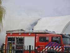 Uitslaande brand in zeecontainers in Marknesse snel onder controle