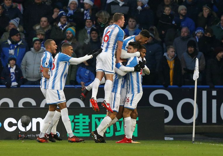 """Soccer Football - Premier League - Huddersfield Town vs Brighton & Hove Albion - John Smith's Stadium, Huddersfield, Britain - December 9, 2017   Huddersfield Town's Steve Mounie celebrates scoring their first goal with teammates   REUTERS/Andrew Yates    EDITORIAL USE ONLY. No use with unauthorized audio, video, data, fixture lists, club/league logos or """"live"""" services. Online in-match use limited to 75 images, no video emulation. No use in betting, games or single club/league/player publications. Please contact your account representative for further details."""