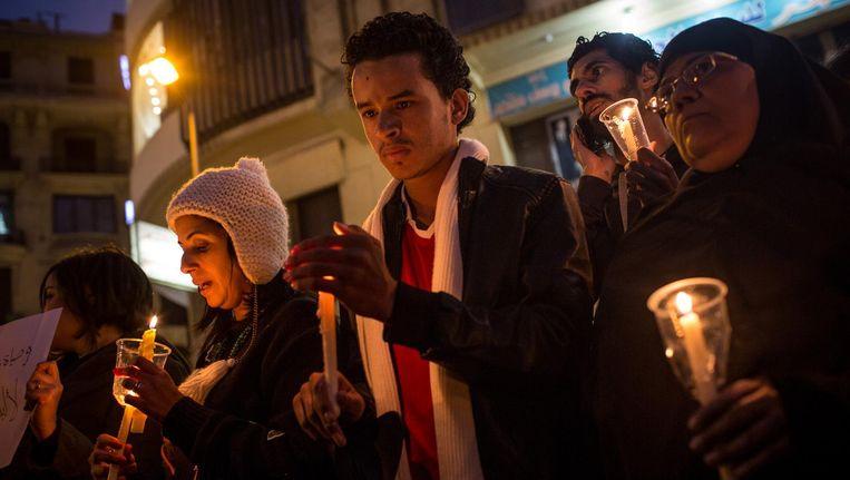 Herdenkingstocht na de aanslag van afgelopen zondag op de koptische kathedraal in Caïro, die 25 slachtoffers eiste. Beeld Chris McGrath/Getty