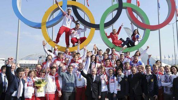 Poetin en de Russische medaillewinnaars.
