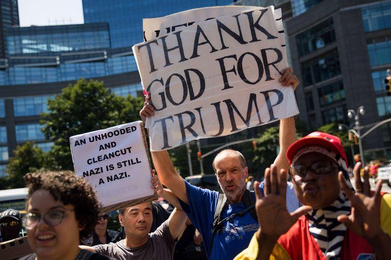 Een tegendemonstrant en aanhanger van Trump tijdens een protest tegen wit racisme.   Beeld AFP
