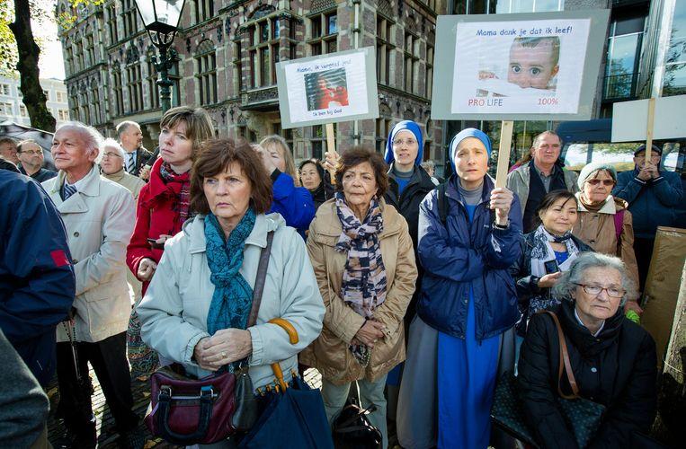 Een demonstratie tegen abortus bij de Tweede Kamer. Beeld ANP
