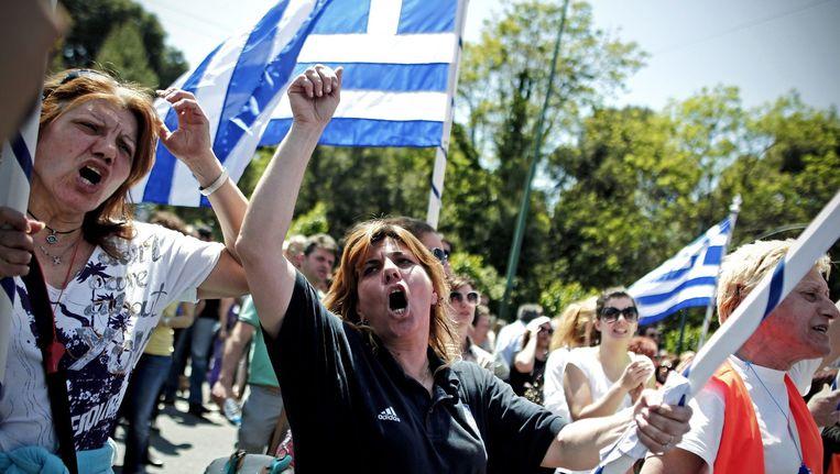 Griekse arbeiders tijdens een protestmars vorig jaar. Beeld epa