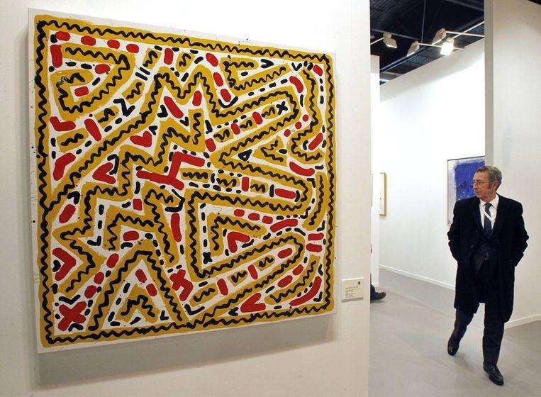 Een schilderij van Keith Haring op een tentoonstelling over moderne kunst in Madrid. Beeld epa