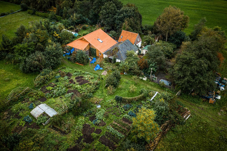 Luchtfoto van de boerderij in Ruinerwold. Beeld Hollandse Hoogte / Rob Engelaar