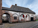De voormalige Volmolen, naast de Koppelpoort, biedt nu onderdak aan De Katoendrukkerij.