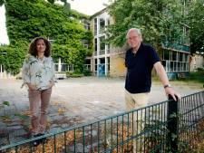 Steun voor bewoners die vervallen school in Utrecht willen redden van de sloop. 'Voorkom verminking van de wijk'