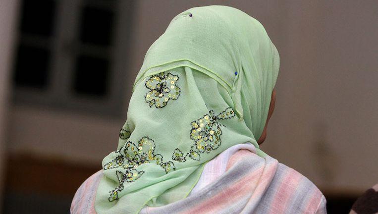 Een vrouw met een hoofddoek © Colourbox Beeld