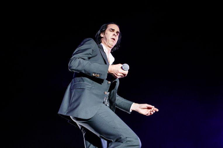 Nick Cave tijdens een optreden in Barcelona.  Beeld WireImage